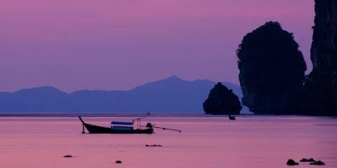 Purple sunset across Thailand beach