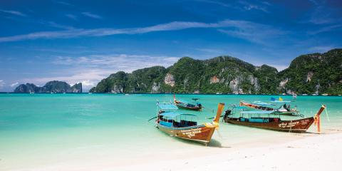 Boats anchored in sea