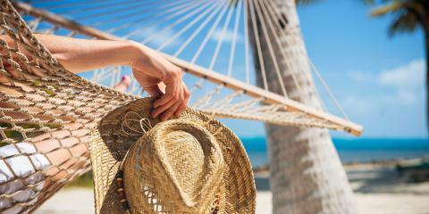 woman relaxing in hammock on beach
