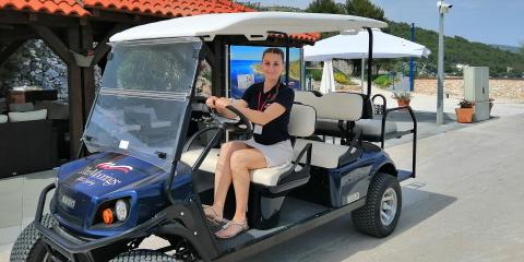 Woman in golf buggy