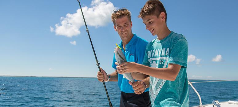 Männer mit einem Fisch in den BVI